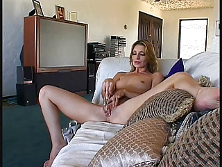 glamorous aged cougar masturbates with sex tool