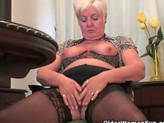 chubby granny in stockings plays with sex toy