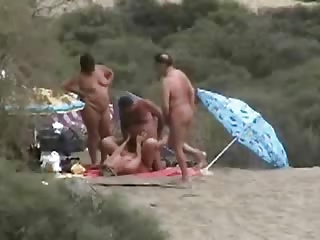 mature couples having fun at nude beach