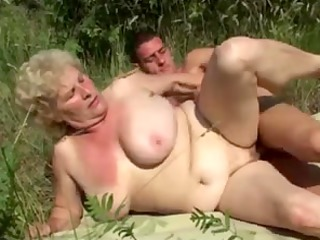 german granny outdoor with juvenile man by troc